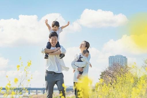 A family taking a walk while having fun