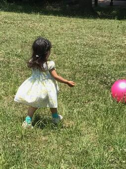 A girl playing with a ball
