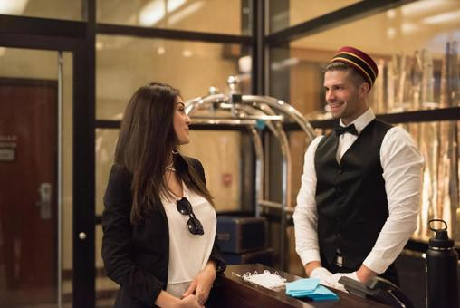 Bellboy talking and women 2