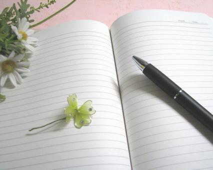 Flowers and four leaf note