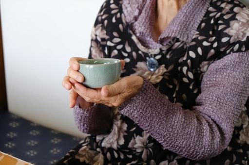 Elderly people (women) drink tea Tea drinking friends Image Stock Photos