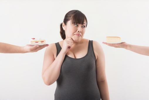 Female surrounded by cake 2