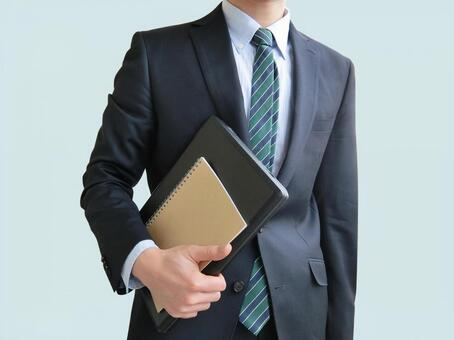 Businessman with computer and notebook-blue background