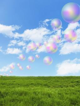 Soap bubble and blue sky and clouds
