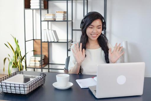 A woman who works by waving her hand to a computer at home