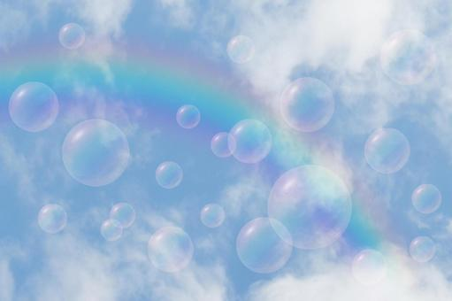 Texture of sky, soap bubbles and rainbow _ background material of sunny blue sky