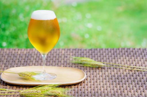 Glass beer and wheat ears