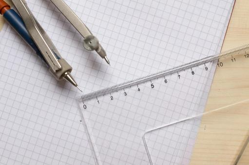 Triangular ruler and compass and note