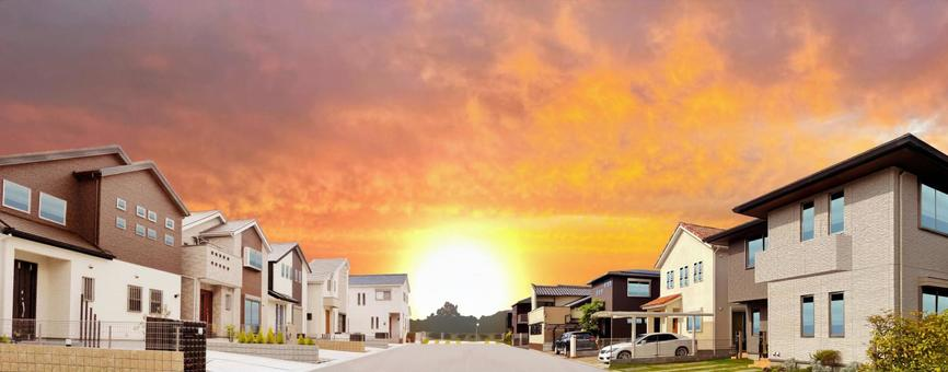 Detached land for sale A panoramic view of a house illuminated by the setting sun