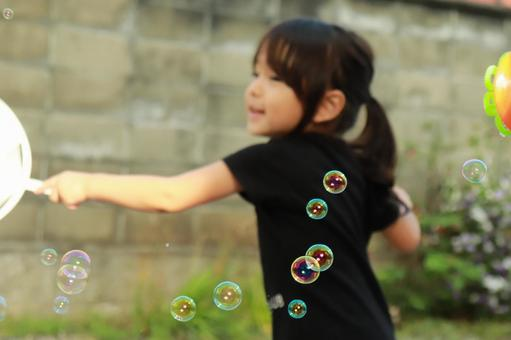 Girl soap bubbles