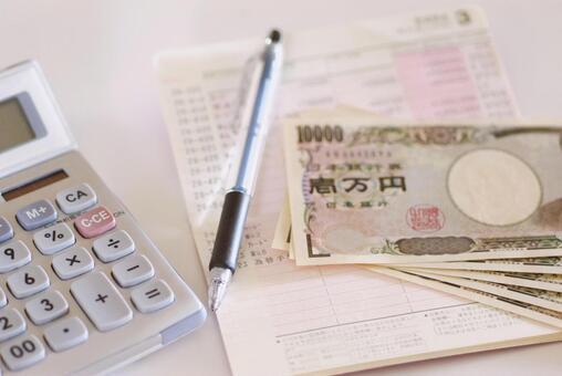 Passbook, banknotes and calculator