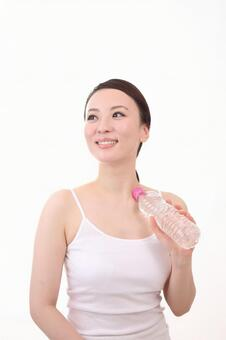 Female with plastic bottle 18