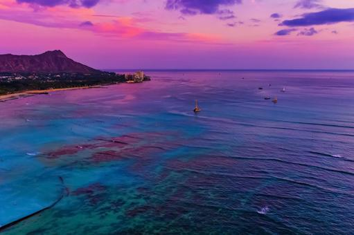 Waikiki beach at dusk dyed in purple