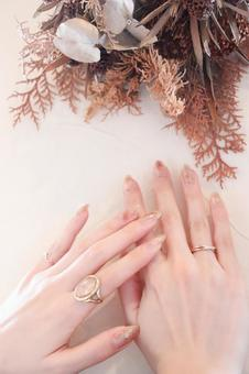 Dried flowers and beautiful female hands
