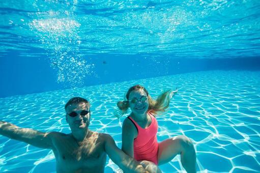 Couples dive underwater shooting 2