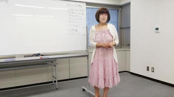 Japanese woman in her 50s giving lecture at lecture