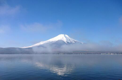 Mt. Fuji with snow under the blue sky