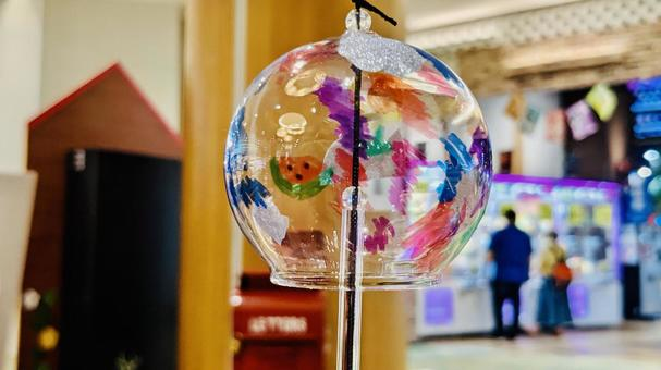 Image of summer Wind chimes and cityscape