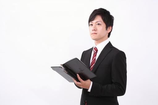 Salary man 6 watching a notebook