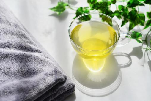 Herb tea and gray towel