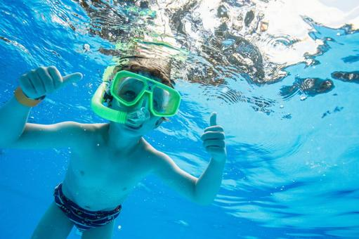 Boys dive in the pool with a snorkel 8