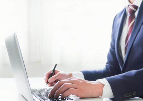 Businessman with laptop and pen