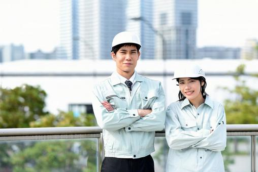 Male and female workers with arms folded