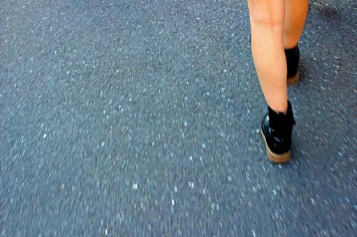 The foot of a walking woman