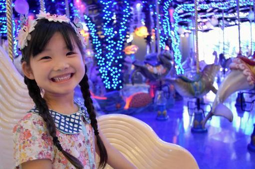 Kids riding merry-go-round