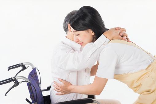 A nurse and a wheelchair male 9