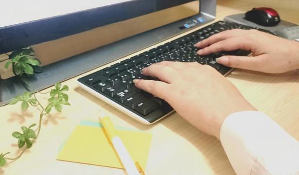 Hands doing keyboard input