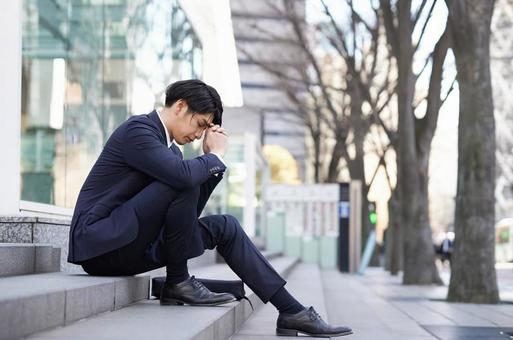 Japanese male businessman suffering from anxiety