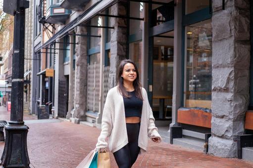 Tourists and Mexican women enjoying shopping in downtown Canada