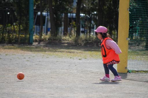 Girl aiming for a rolling ball Soccer ball kick