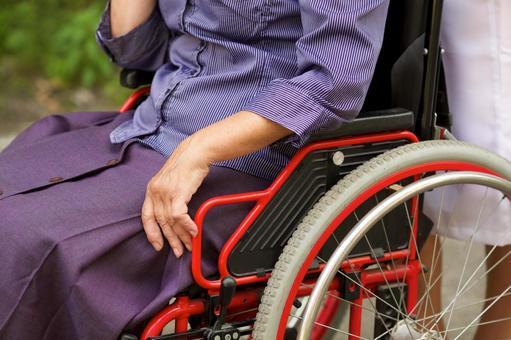 A woman's waist 1 on a wheelchair