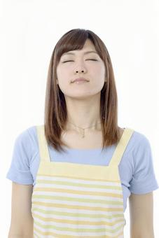 Housewife facing upwards with eyes closed