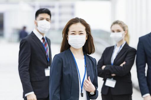 Business team wearing a mask