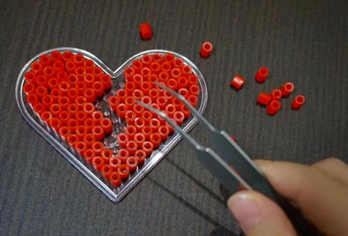 Heart made of red beads (cracked)