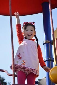 Children playing with playground equipment