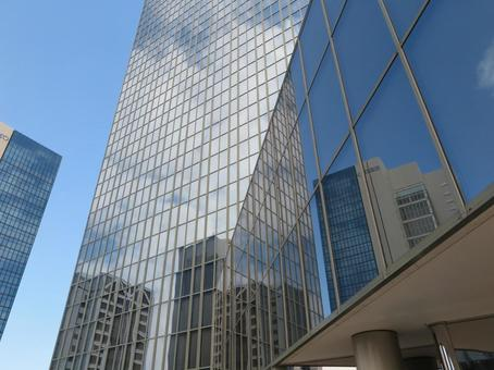 Buildings reflected in the window