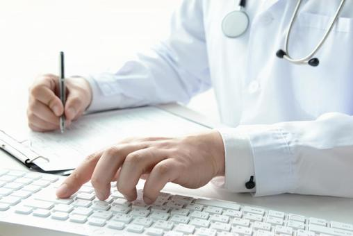Doctor using a personal computer