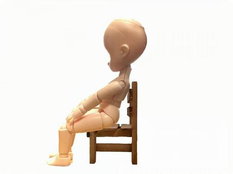 Sit in a chair in a bad posture