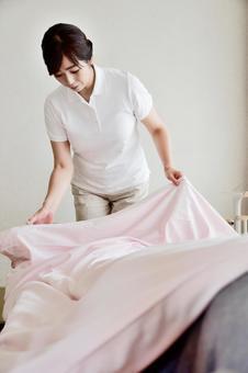 Caregiver 1 putting back futon