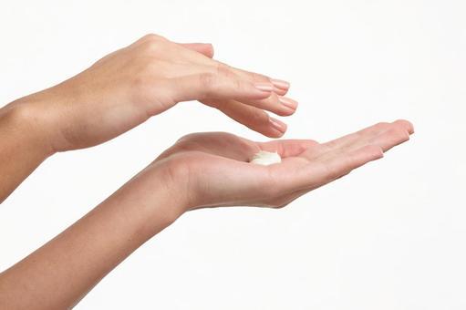 Cream and female hand 8
