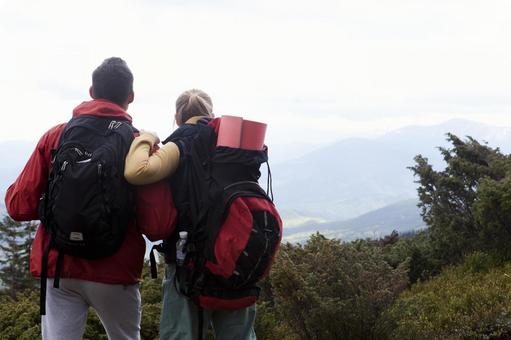 A couple standing and seeing the mountain 2