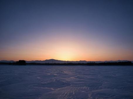 Snowfield and sunset