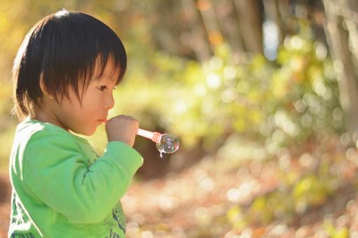 Boy playing soap bubble