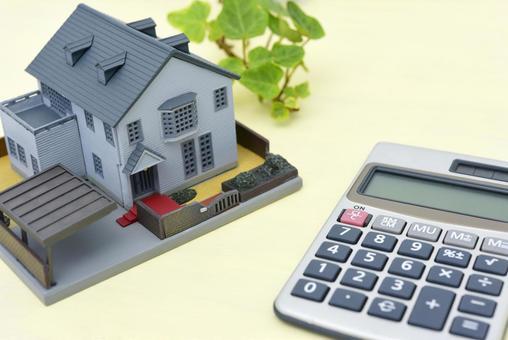 부동산 매매의 이미지 주택 모형과 계산기