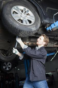 Automobile mechanic servicing tires 7