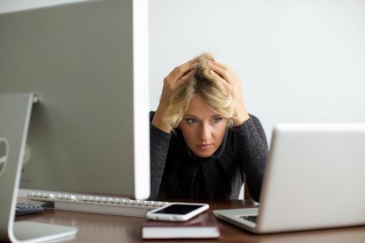 Working mother sandwiched between desktop computer and laptop computer 4
